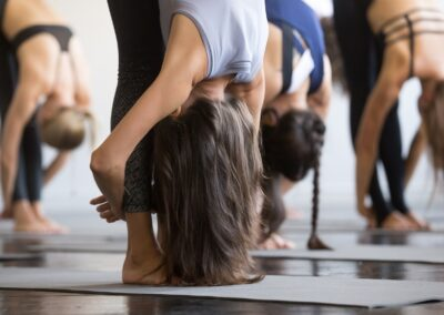 Group,Of,Young,Sporty,People,Practicing,Yoga,Lesson,,Standing,Forward